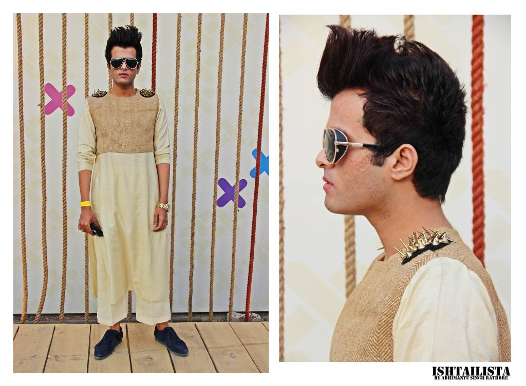 Rahul Wadhwa Thumps up to Rahul for artistically transforming the typical ethnic kurta into something ultra modern and futuristic. Loved the statement glasses and ofourse the punk studs on the shoulder.