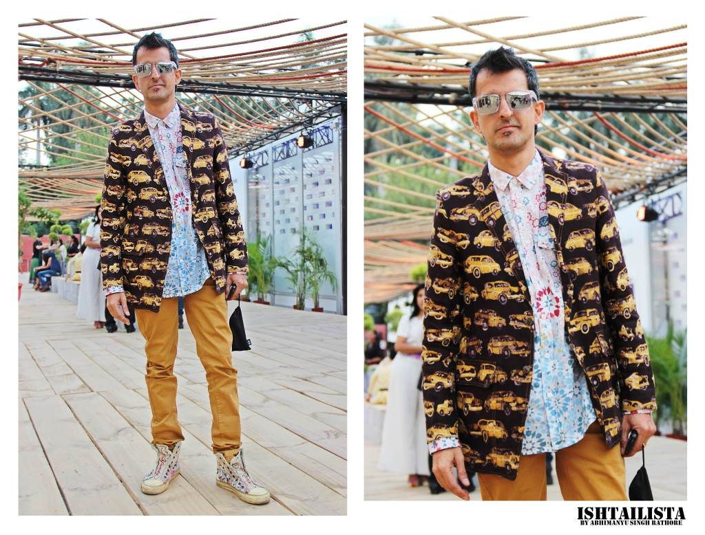 Love the quirky printed jacket paired with printed shirt and tan chinos. Did you notice the stunning Ed Hardy Shoes.