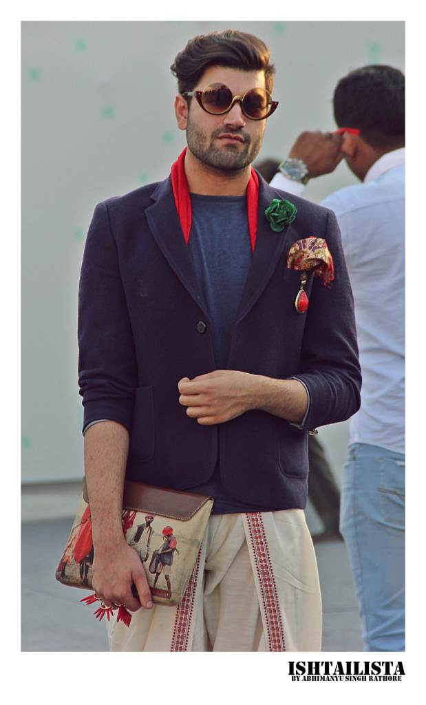 Lovee quirky the quirky appeal of styling blazer with dhoti pants and with printed men clutch.