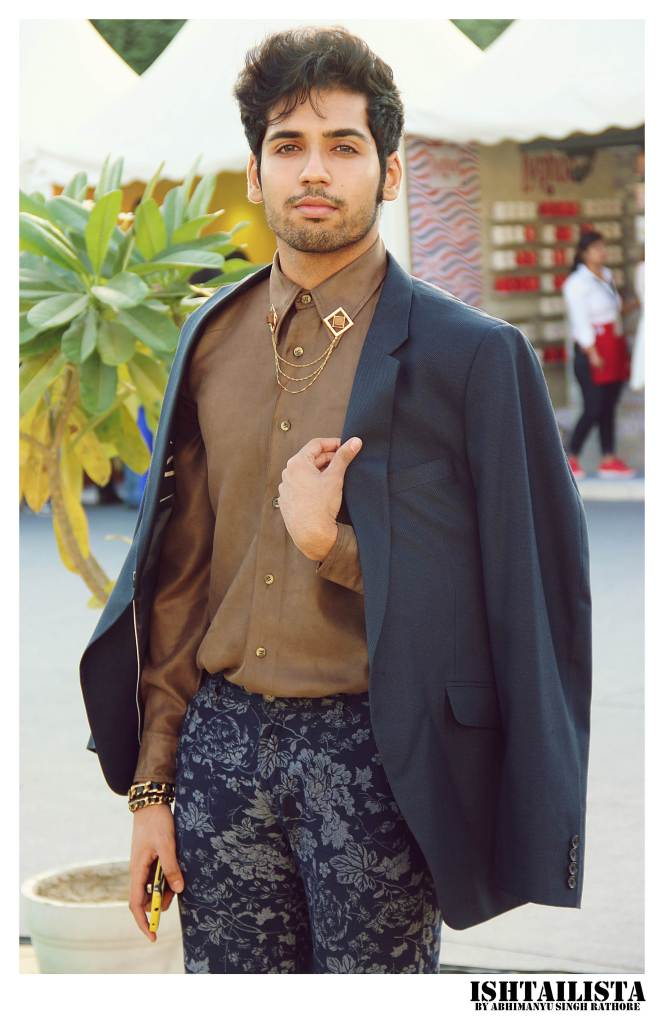 Ishaan Singhal You can style your shirt with collar pins for an eccentric look.