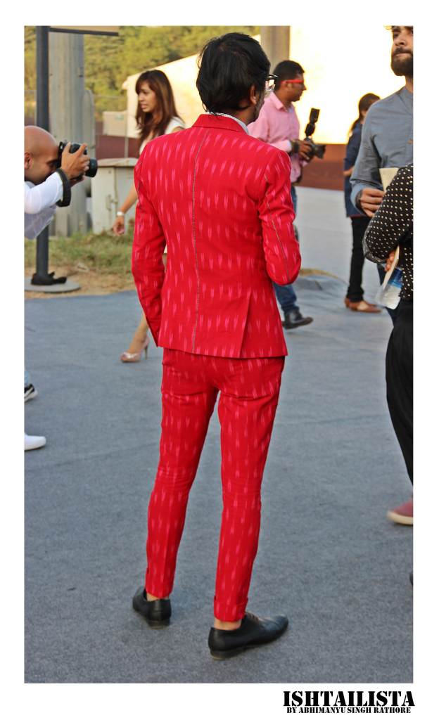 Jiten Thukral, one hal of artist duo 'Thukral & Tagra'. His suit styles are always quirky and I love this red burst of color here.