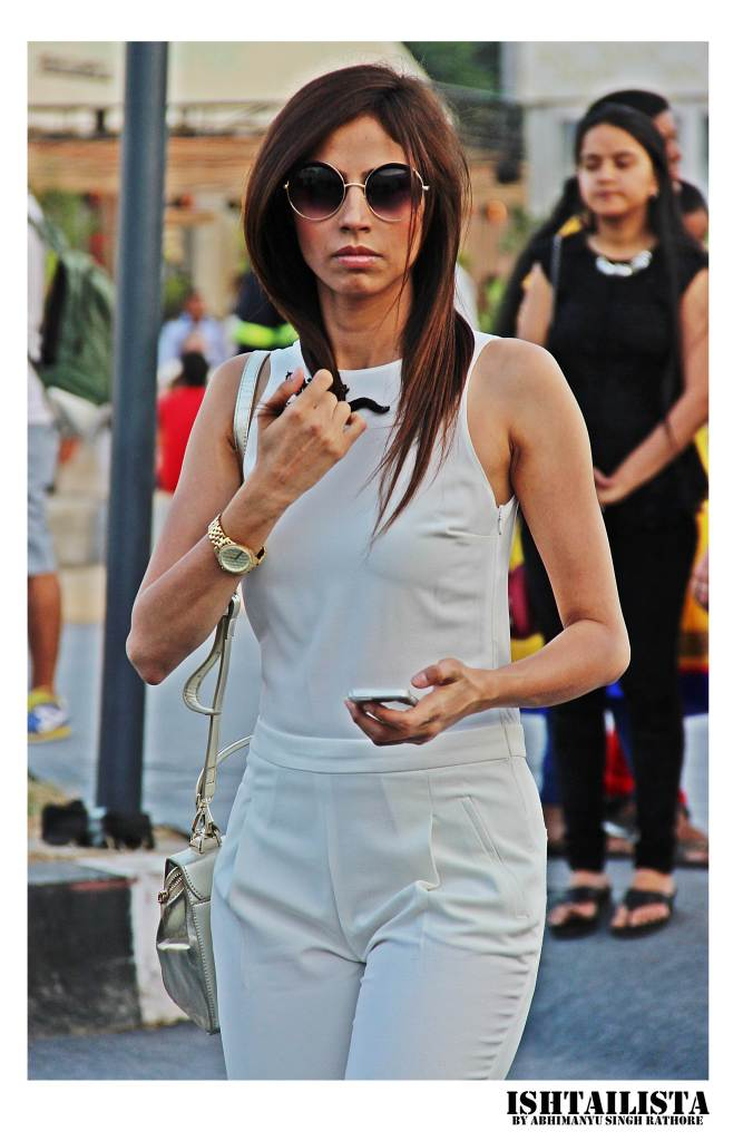 White jumpsuit styled with round frames and watch looks very coporate chic. This works perfectly for board meetings to formal functions.