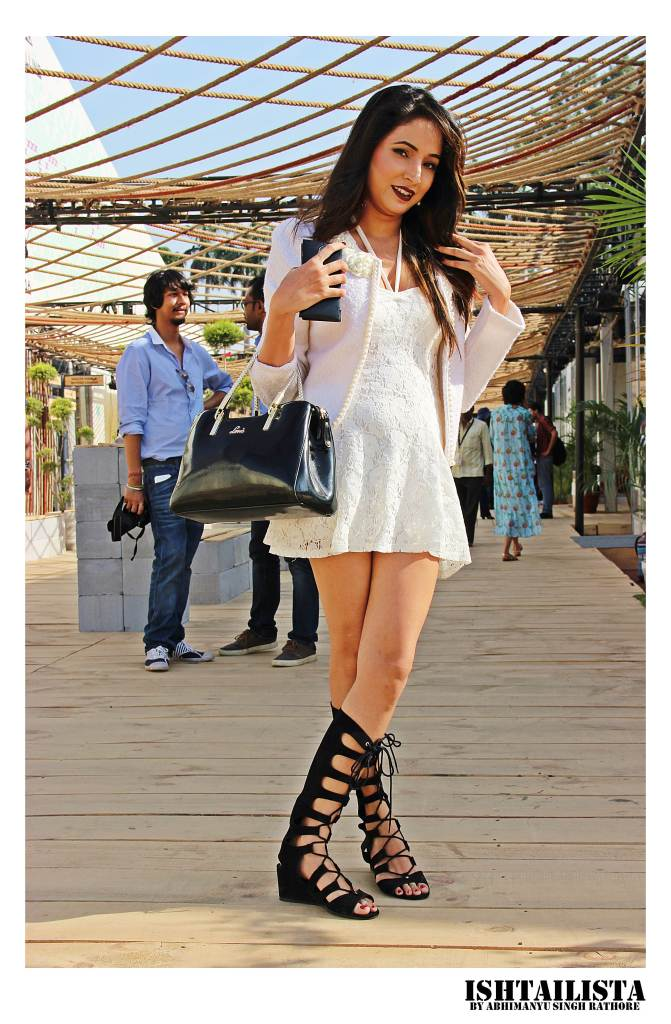 Kajal of India fashion blogger. Love the way she has layered white on white and styled them with black gladiator sandals.